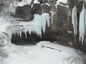 students  view the frozen falls on their way to class...