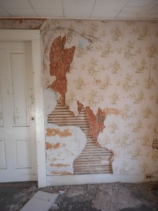 wall paper layers of the times when someone lived here