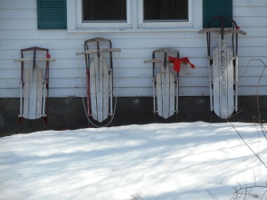 sleds arranged from a long winter of good times