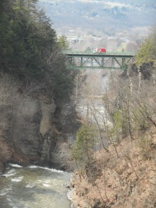 red truck crossing a chasm of time