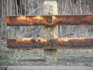 rusting on the roadside guardrail