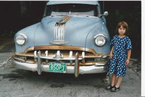 asked to pose with an old Pontiac her stoic look...