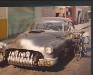 Puebla Mexico 1978 my bicycle leans against the old Buick