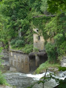 Van Natta's dam water flowing by  the old hydro plant...