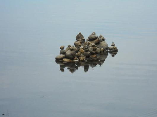 still waters with stone piles