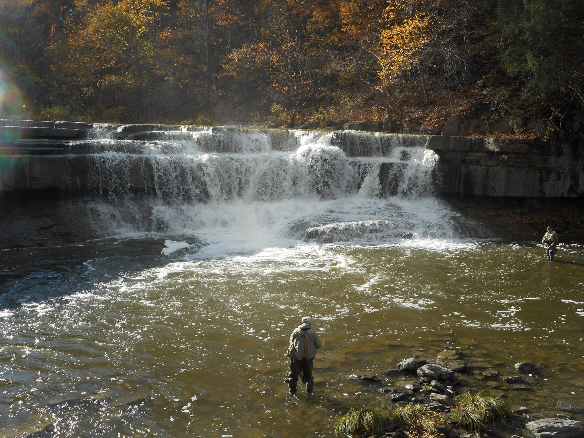 the day's catch... just below the falls a fisherman.jpg