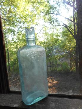 bottle In the garage on the window sill watching the days come and go ...